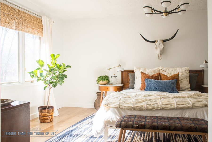 Check out this Mid-Century Bedroom. It has a DIY vintage mid-century bench and lots of plants.