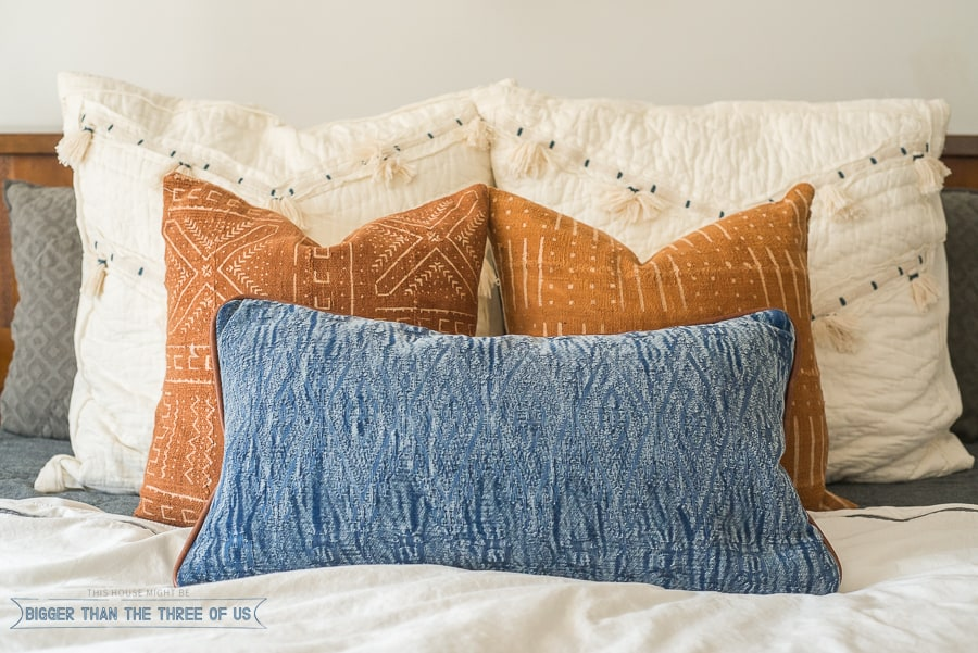 Love pillows? I do too! Check out how I styled them in this eclectic, mid-century inspired bedroom.