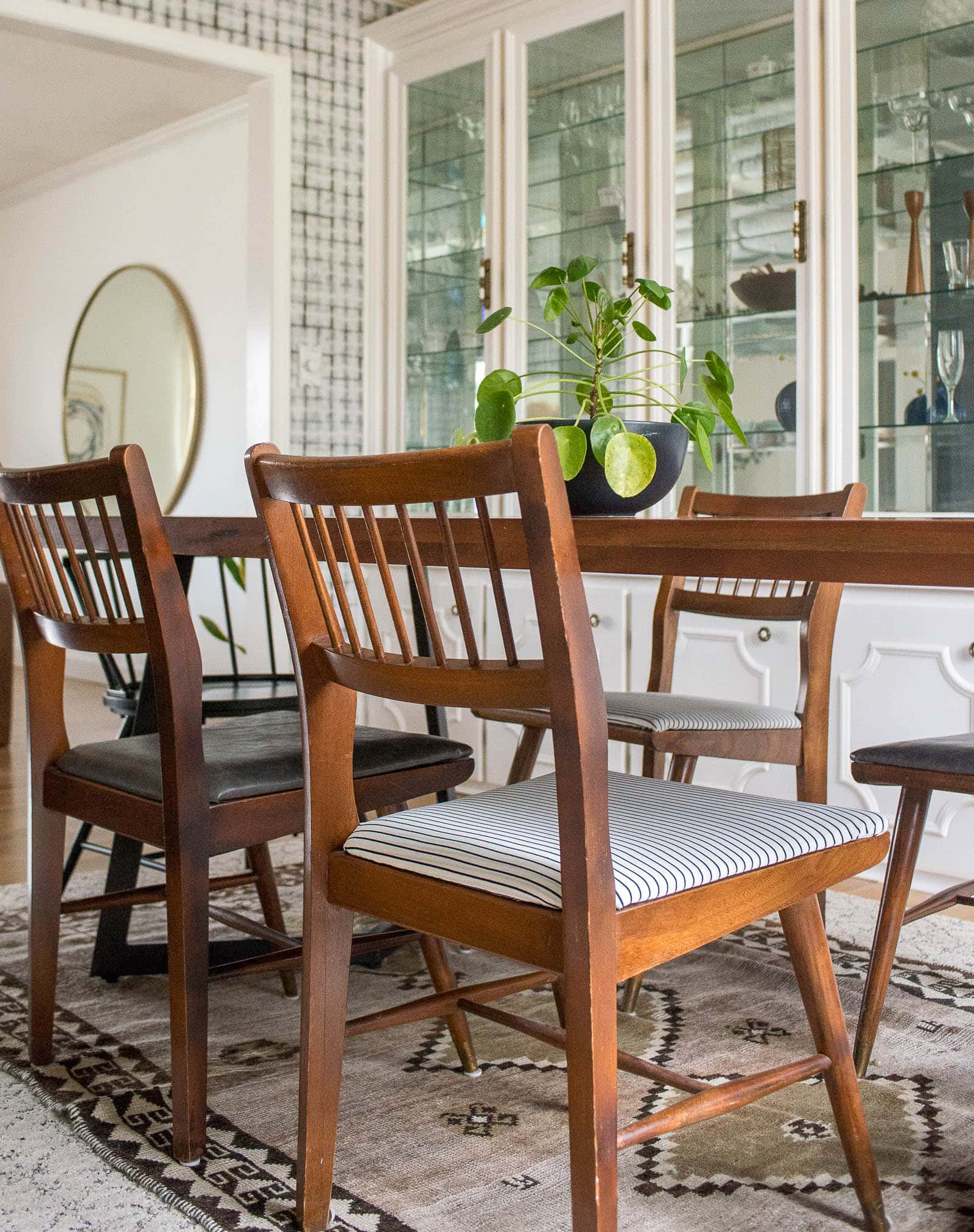 Midcentury dining room chairs around table