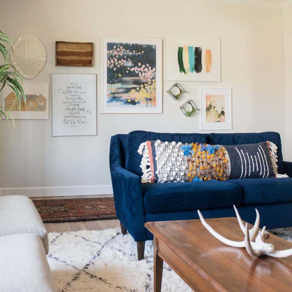Living Room with Navy couch, moroccan rug and gallery wall