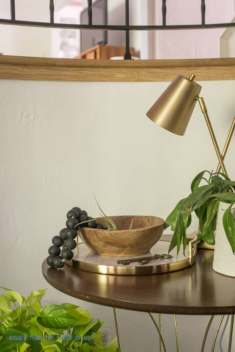 Tabletop styling with lamp, plant and tray