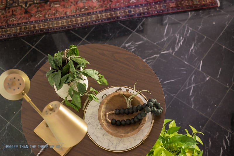 Tabletop styling with lamp, plant, wood bowl and tray