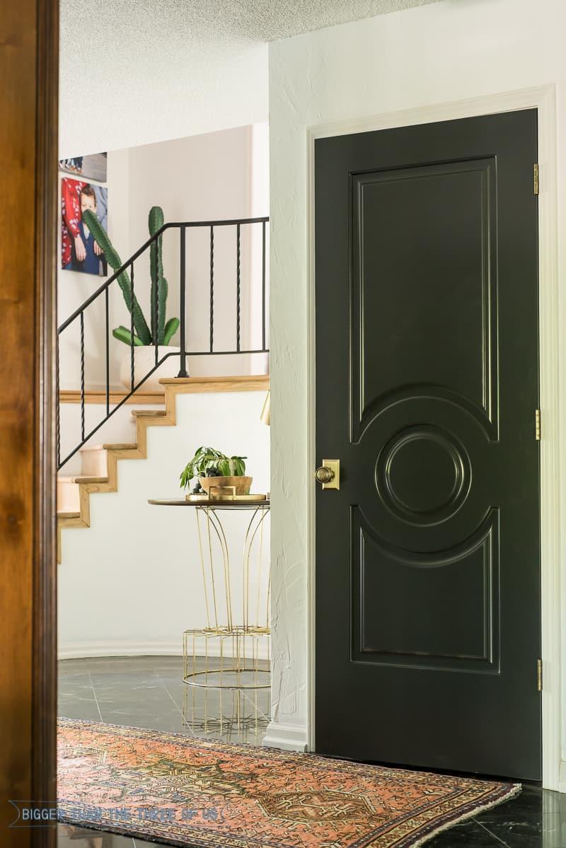 Round Entryway with dark doors and dark flooring