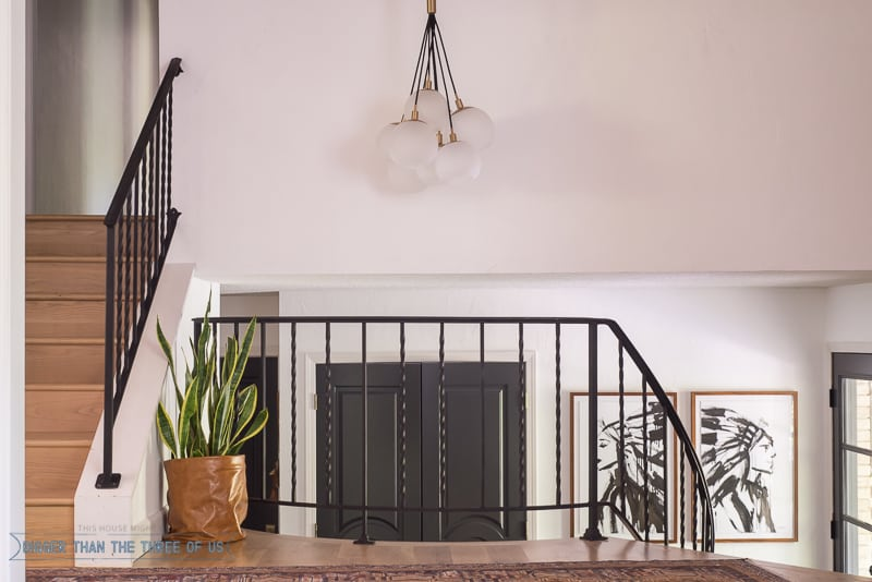 Modern Entryway with dark railing and dark doors
