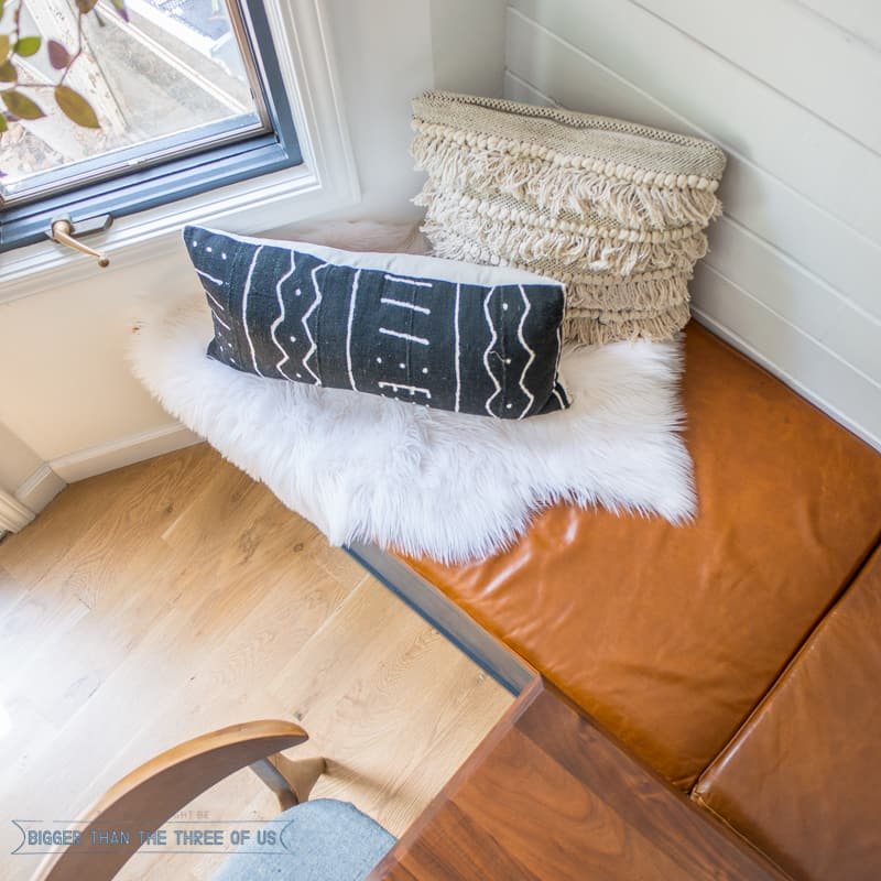 Updated Eat-In Kitchen with Leather Bench Seat, Highland Cow Painting, shiplap and more!