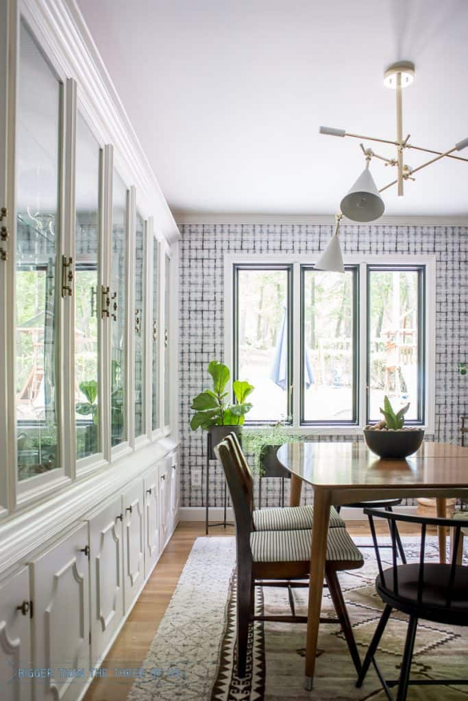 Built-in China Cabinet in Dining Room with Mid-Century furniture, shibori wallpaper and plants