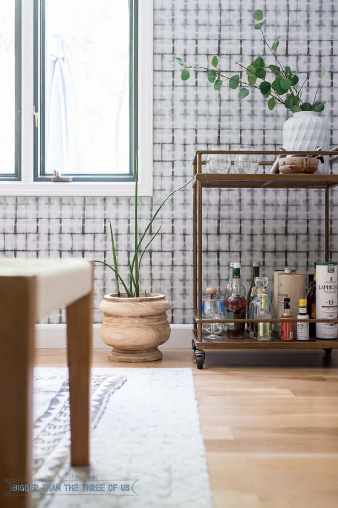 Wood planter, brass bar cart in Mid-Century Dining Room