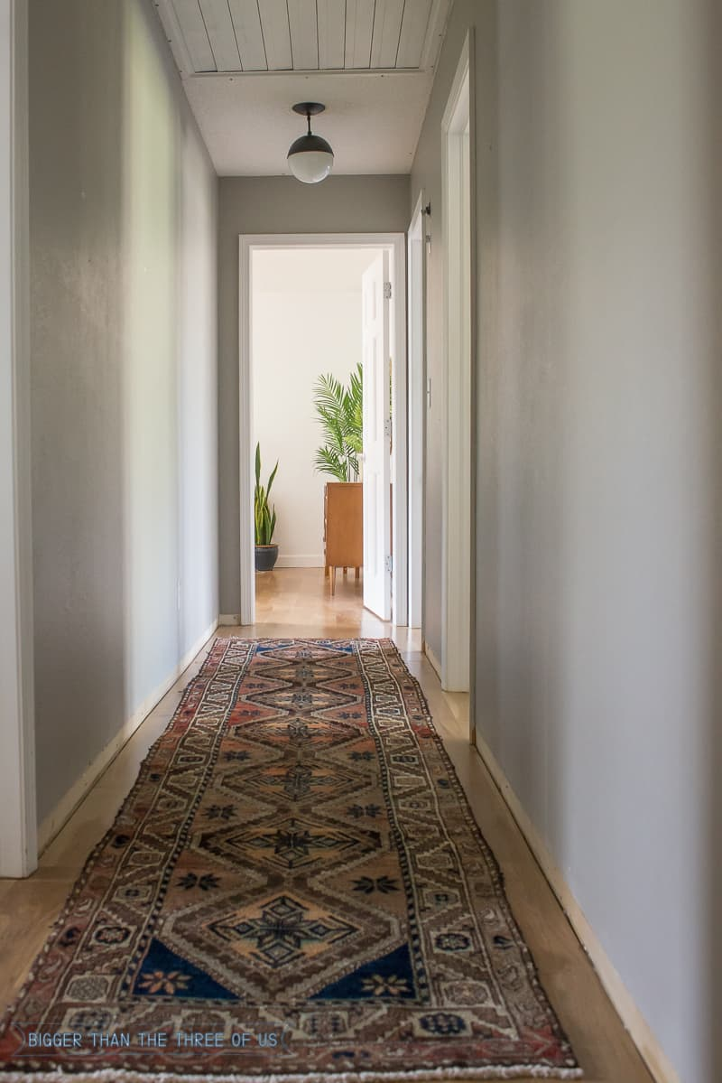 Persian rug in hallway with gallery wall