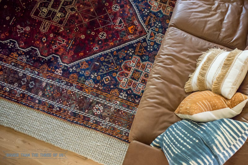 Vintage rug layered over jute rug in living room. How to Search for Cheap Vintage Rugs
