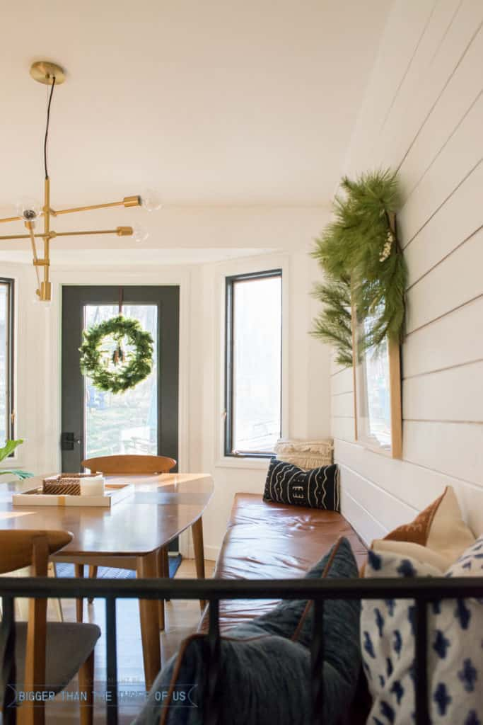 Wreath over patio door in kitchen | Modern Christmas Home Tour