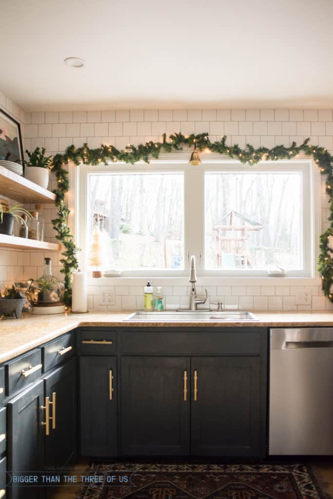 Garland above window over sink in kitchen.