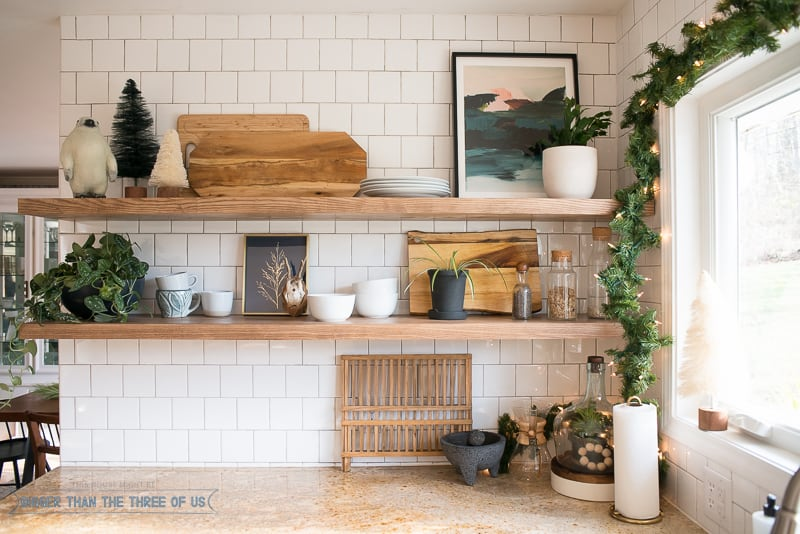 Open Shelves in the Kitchen with art and Christmas Decor