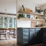 Dark cabinets with floating shelves in kitchen with Christmas Decor