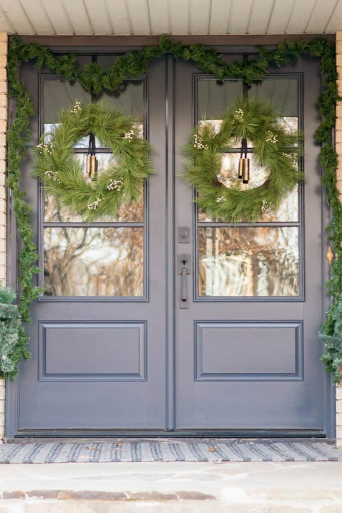 Double front doors with glass decorated for Christmas | Front Porch Christmas Decorating Ideas