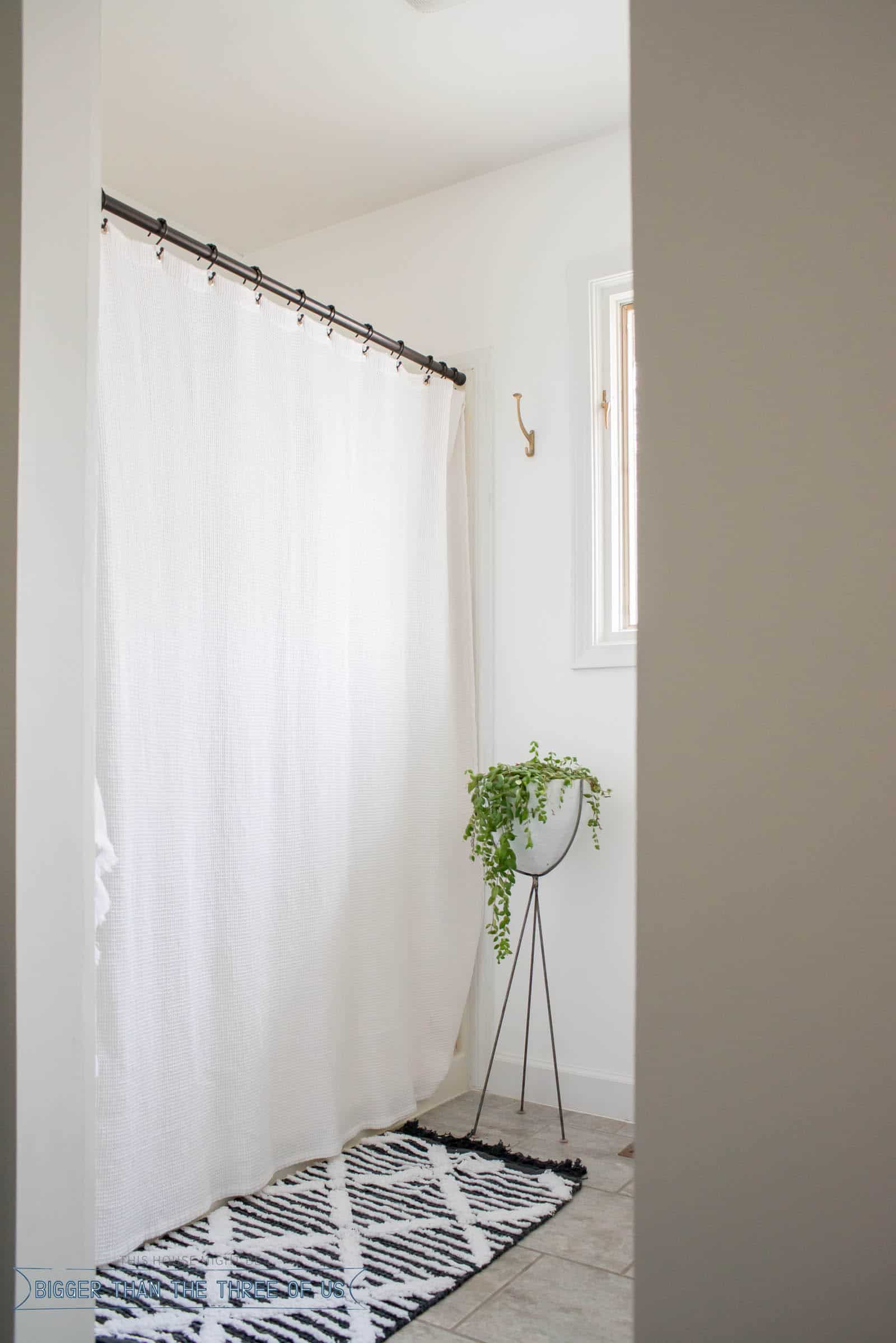 White Curtain in shower gives an airy vibe