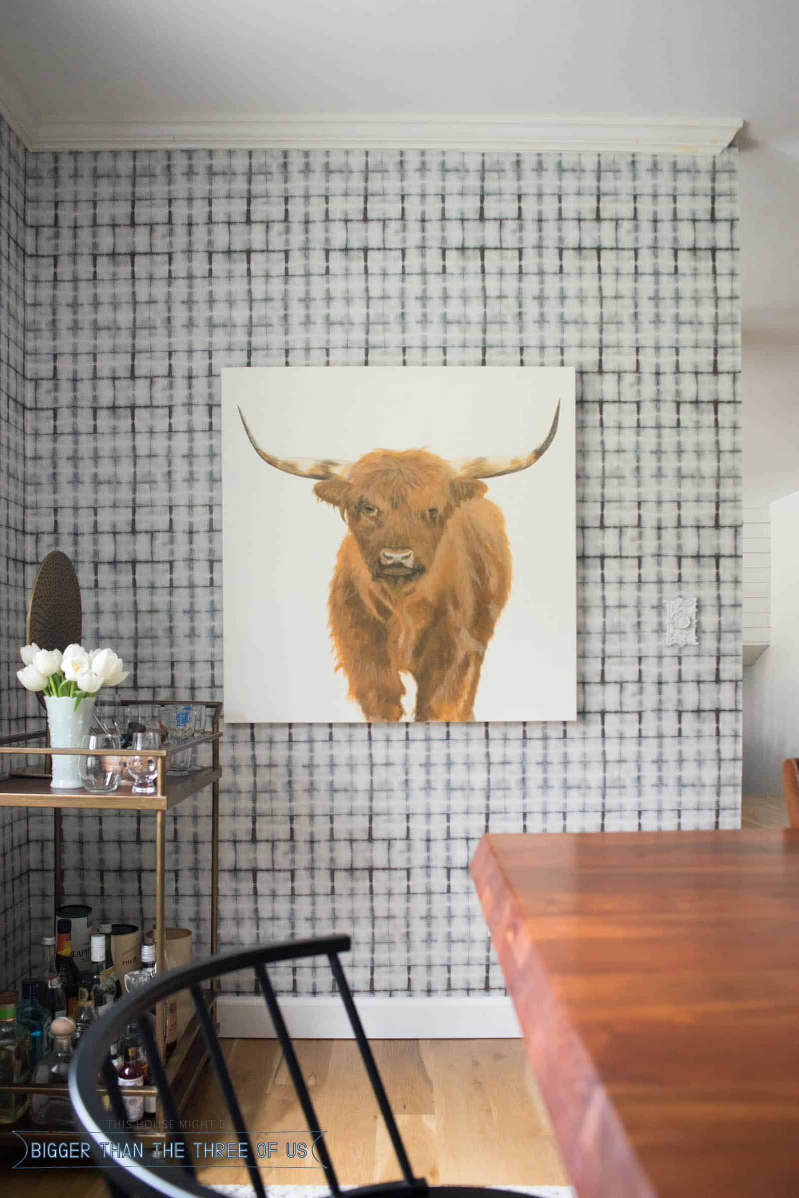 HIghland Cow Painting with a barcart in modern dining room