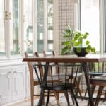 White built-in china cabinet in modern formal dining room