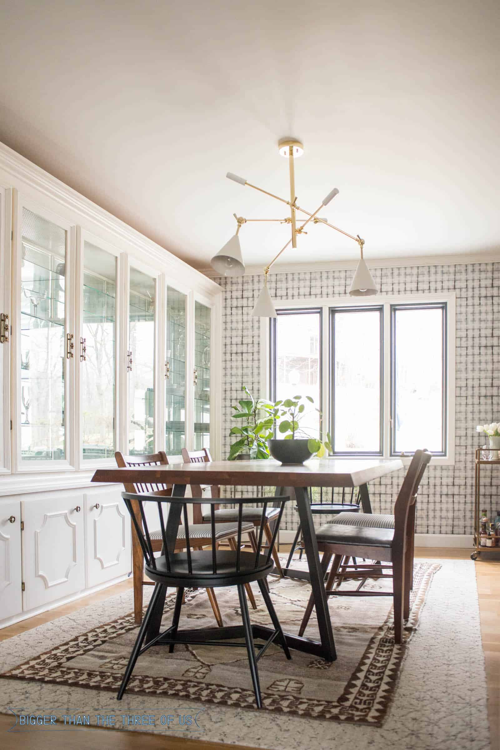 Blue and White vintage dining room with wood floors, wallpaper and midcentury modern furniture