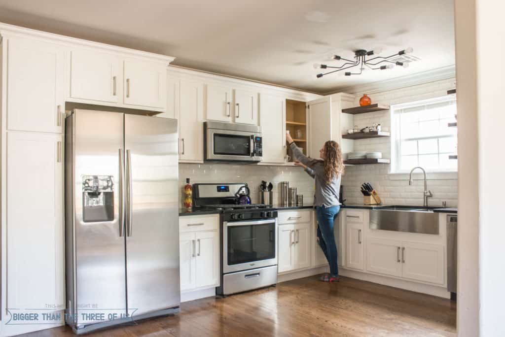 Modern white kitchen with open shelves in our Oklahoma City HomeAway Rental.