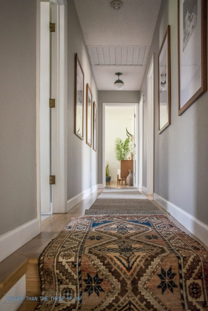 Vintage runner in hallway with gallery wall