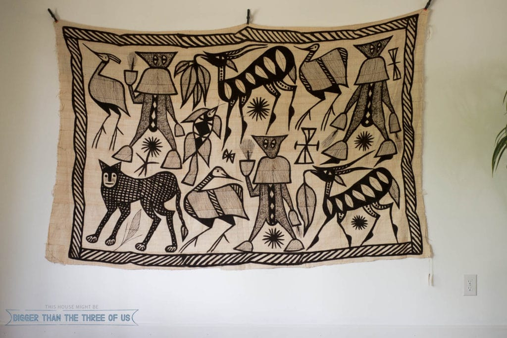 African wall hanging in living room.