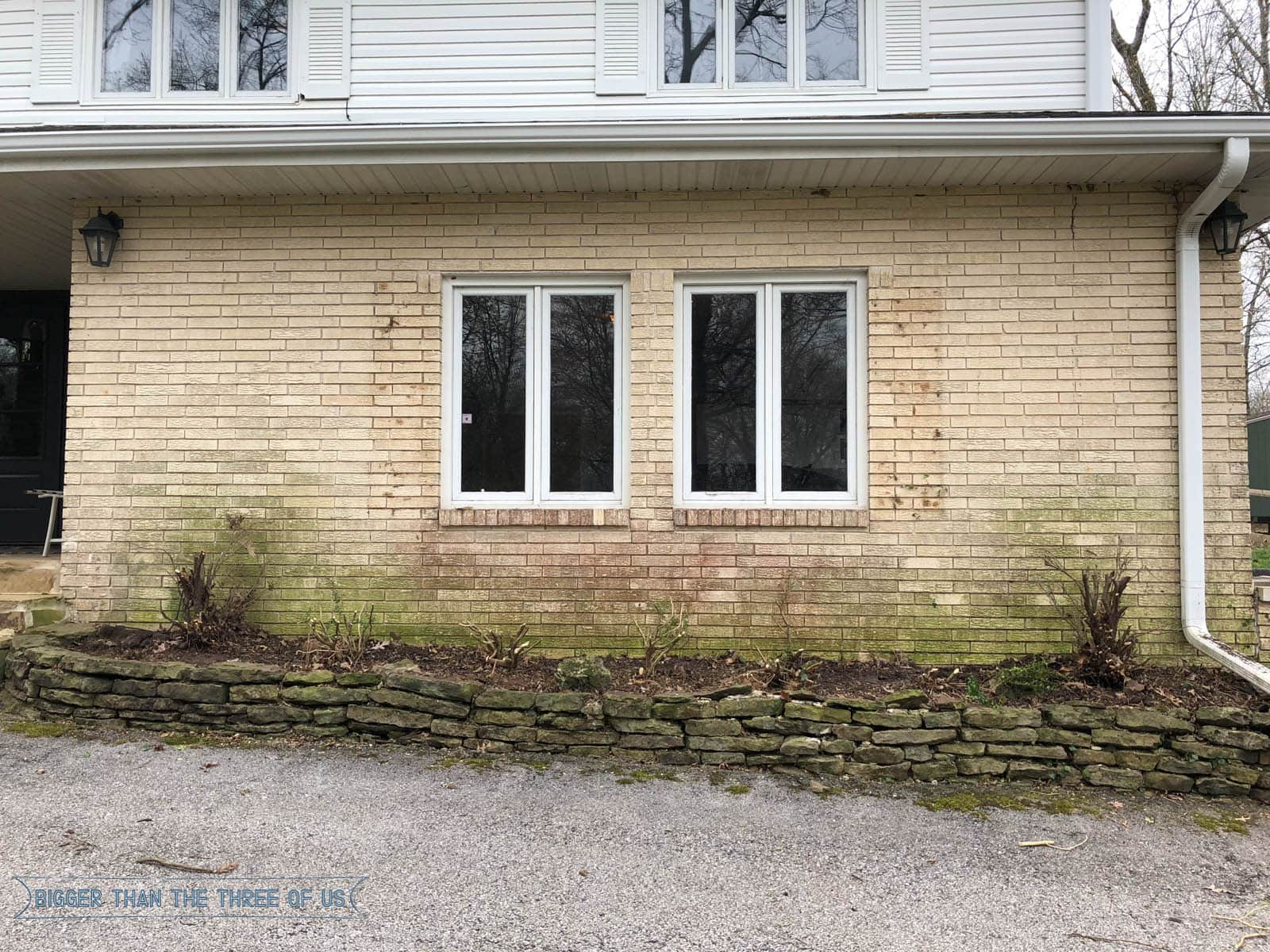 Have you ever thought about how much improvement you can make on the exterior of your home by trimming overgrown boxwood bushes back? Seriously, it's a game changer over here. Come over and see the process of trimming big boxwoods and how the shutter removal before and after. #exterior #beforeandafter #shutterremoval