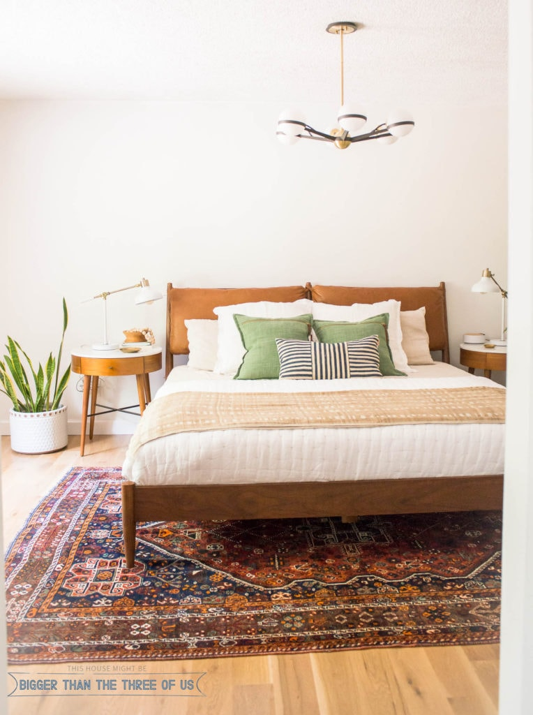 Mid Century Modern Bedroom featuring plants, white walls, boho textures and more. #midcenturymodern #midcenturybedroom