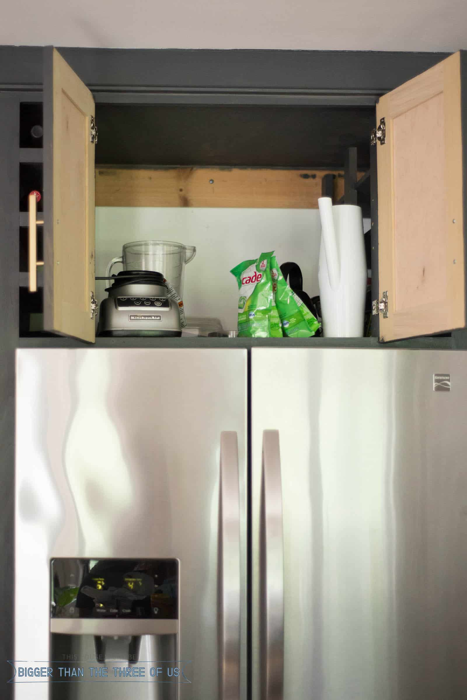How to Organize Above Your Fridge. Kitchen Cabinet organization without spending a ton of money! #budgetfriendly #organization #kitchencabinetorganization