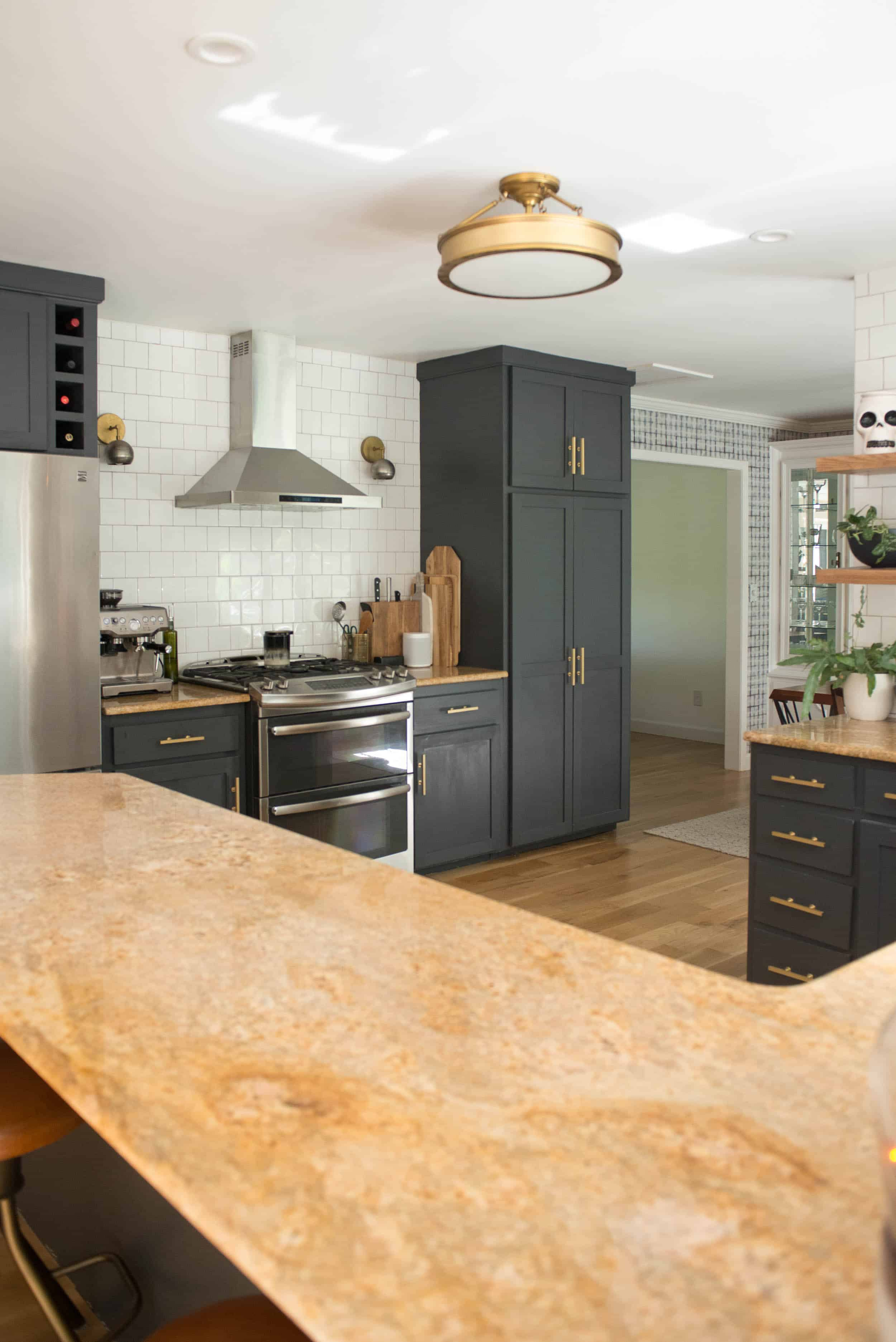 Brass and Black Kitchen with Halloween Decor