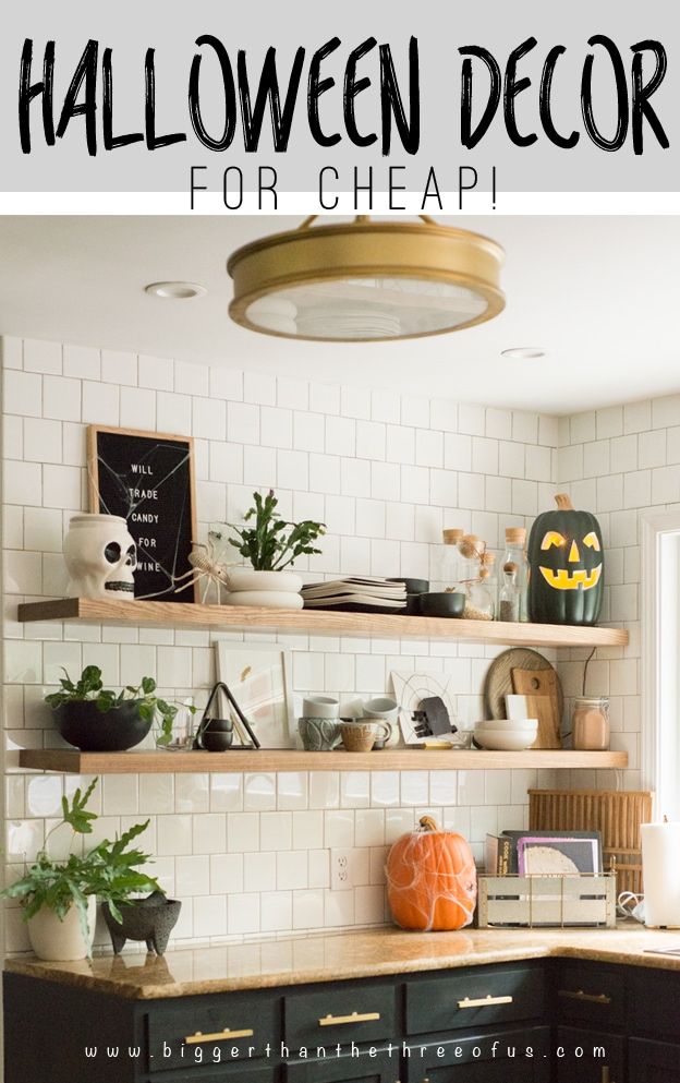 I love putting a sprinkle of halloween decor on my floating kitchen shelves. Come on over and see more Halloween decor ideas for your home. #halloweendecor #floatingshelves