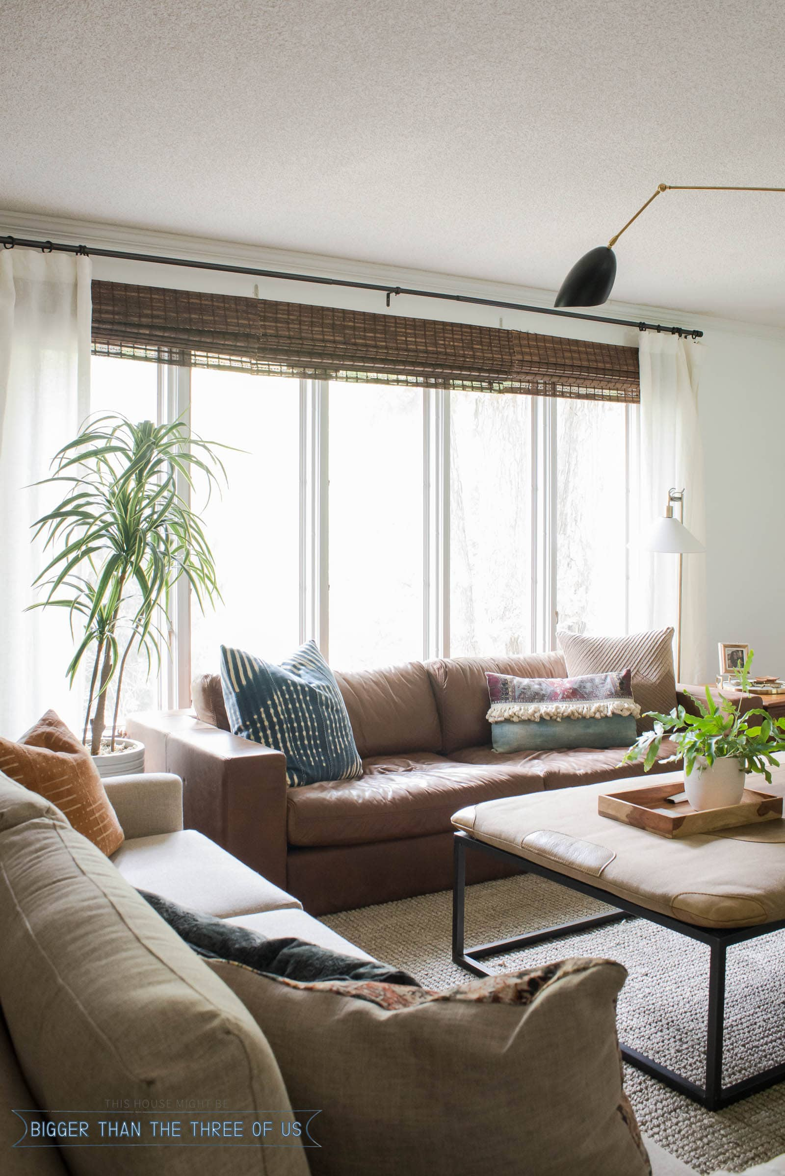 Leather Couch in front of windows in midcentury inspired living room