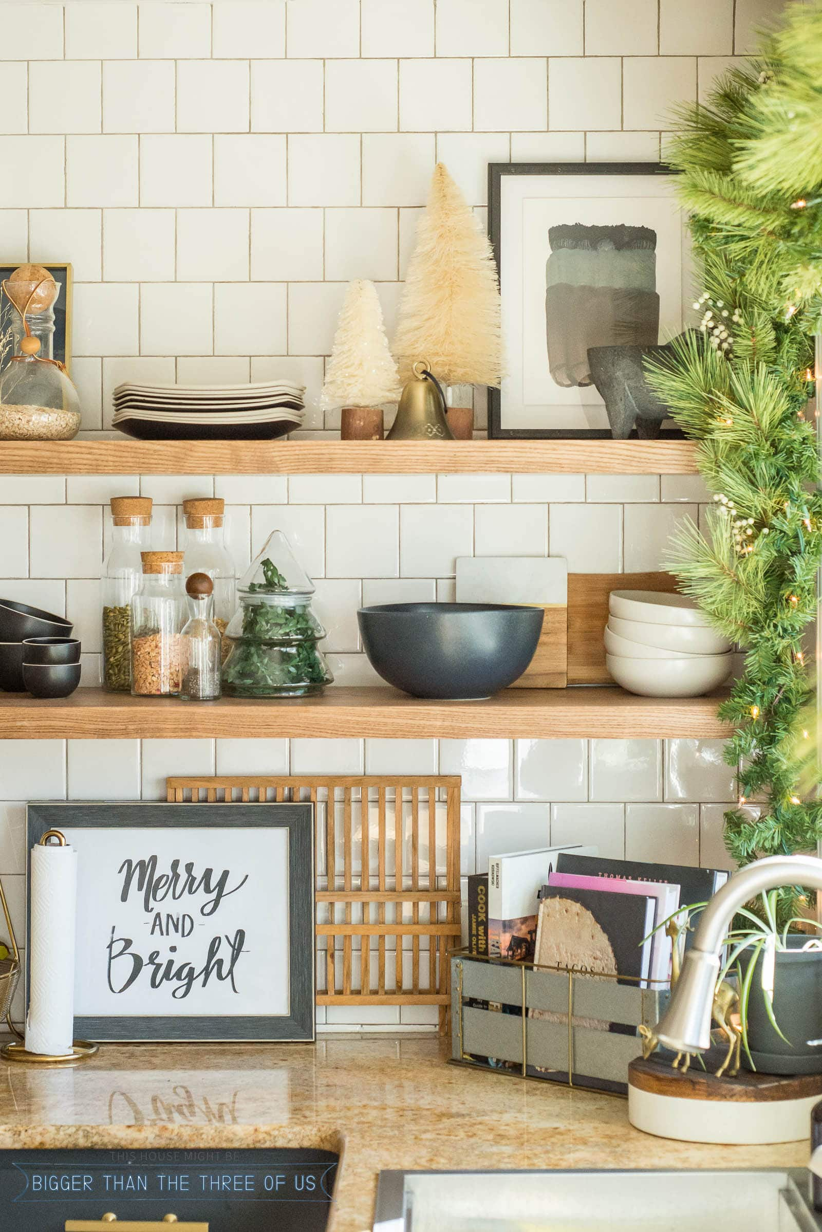 Closeup of ash floating shelves in kitchen decorated for Christmas