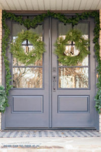 Double Front Door With Cracked Pepper Paint color decorated for Christmas with wreaths on both door and a garland