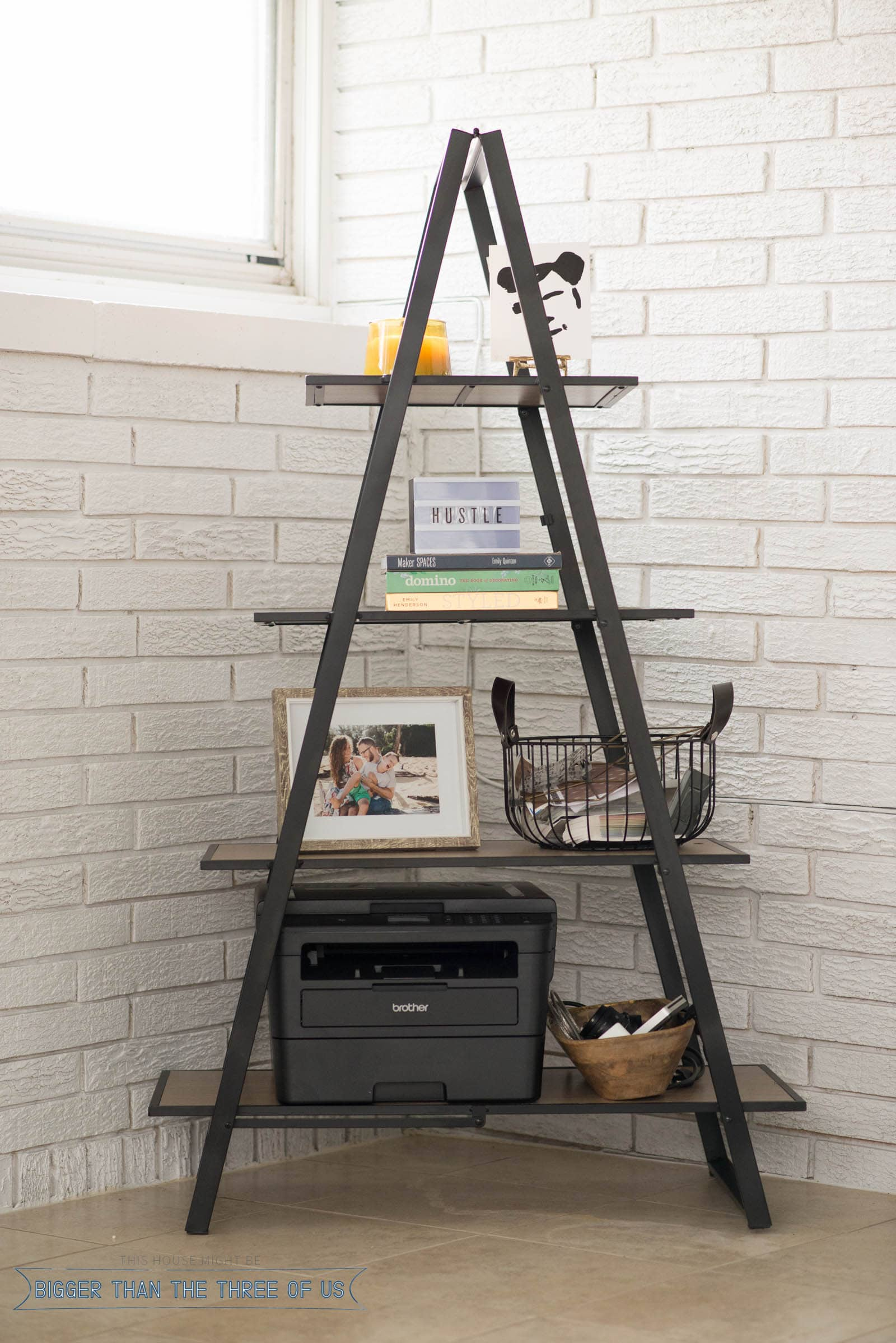 Close-up of A frame shelf in office with printer, basket and office decor styled on the shelves.