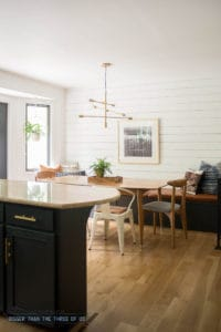 Eat In Kitchen with white modern wood wall treatment, leather bench and mid-century furniture.