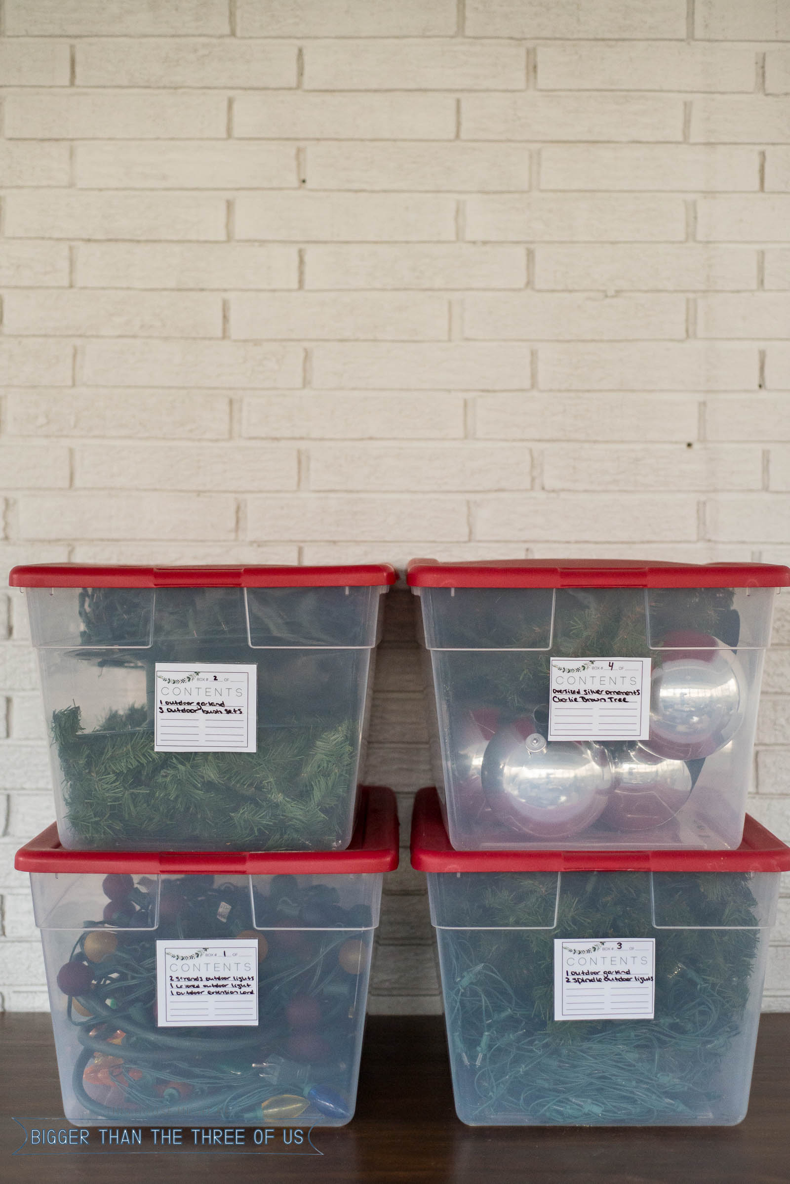 Storage boxes full of Christmas decor with printable storage labels!