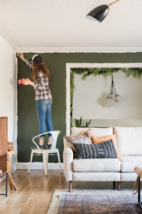 Painting a living room green.