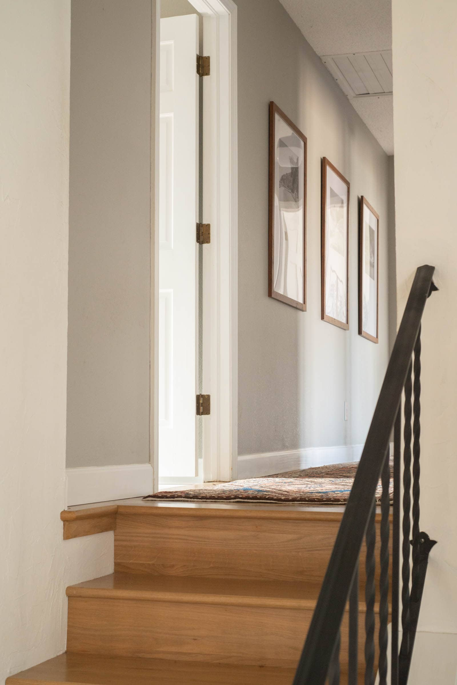 Wood stairs and a gray hallway