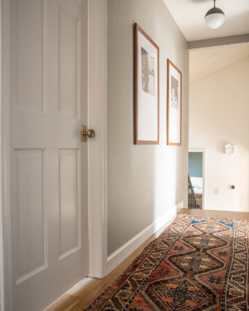 White door and brass hardware in upstairs hallway