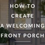 Front door porch with glass front doors and wreath