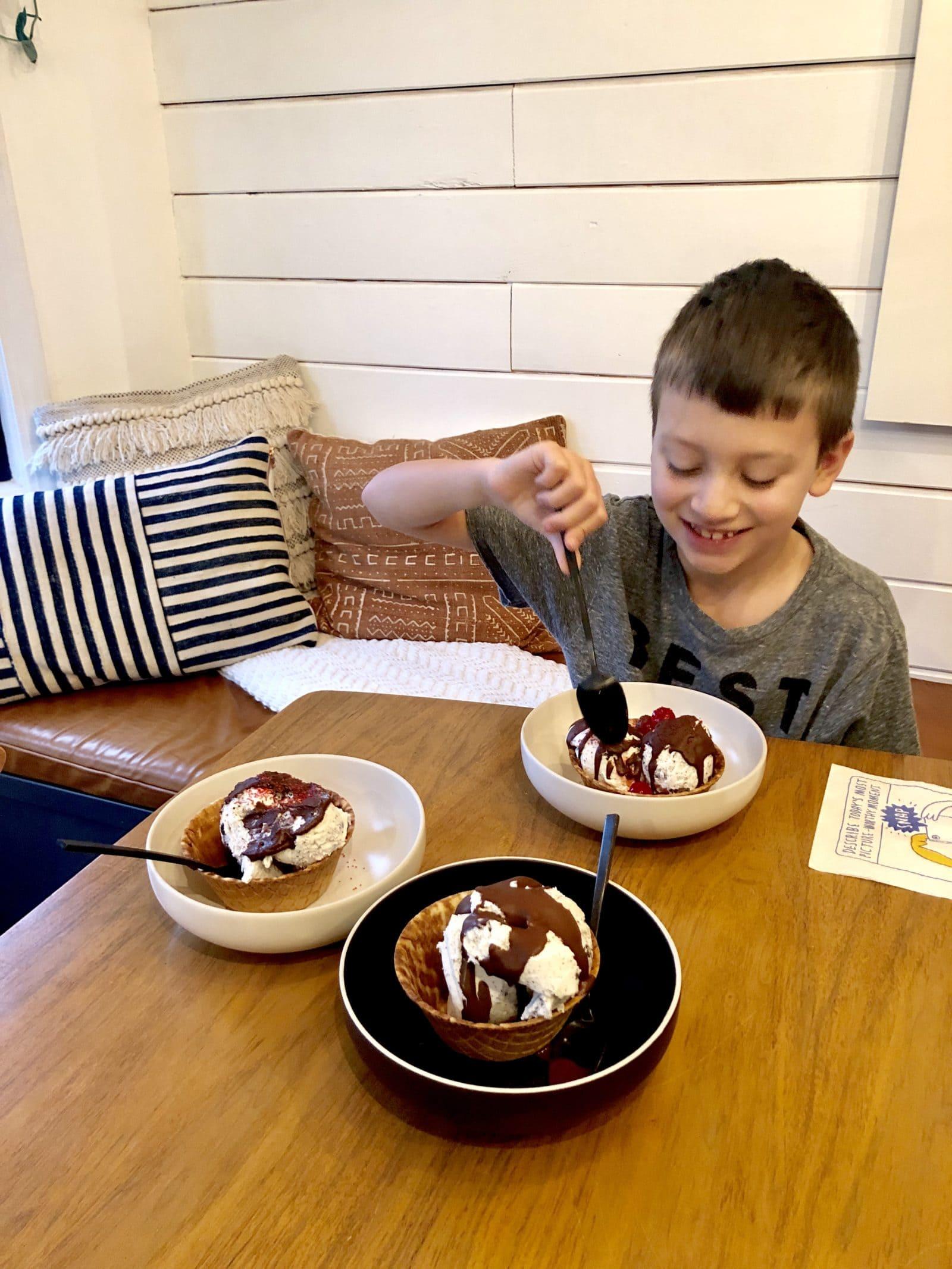 Ice cream sundae with kid smiling
