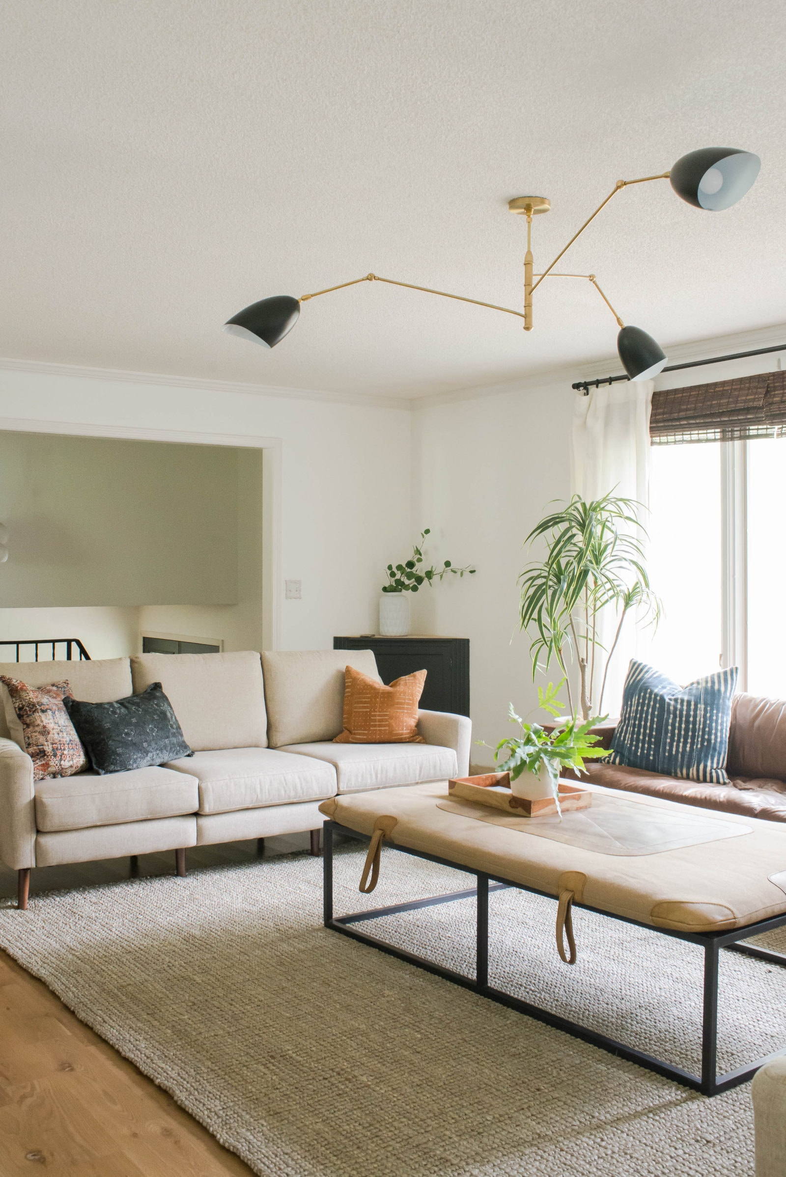 Couch in living room with white walls