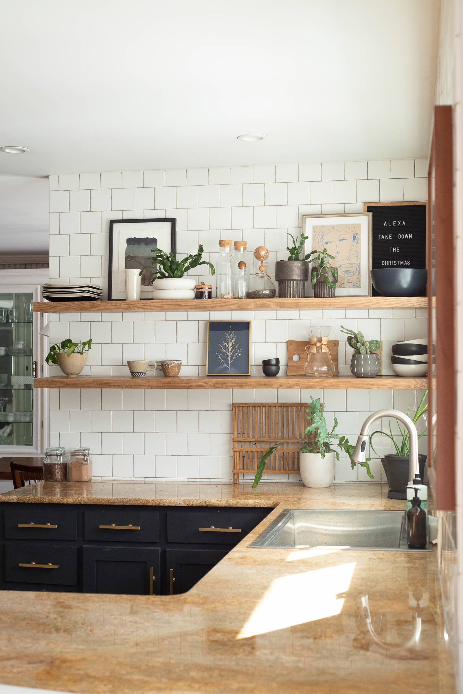 Kitchen shelves decorated with art