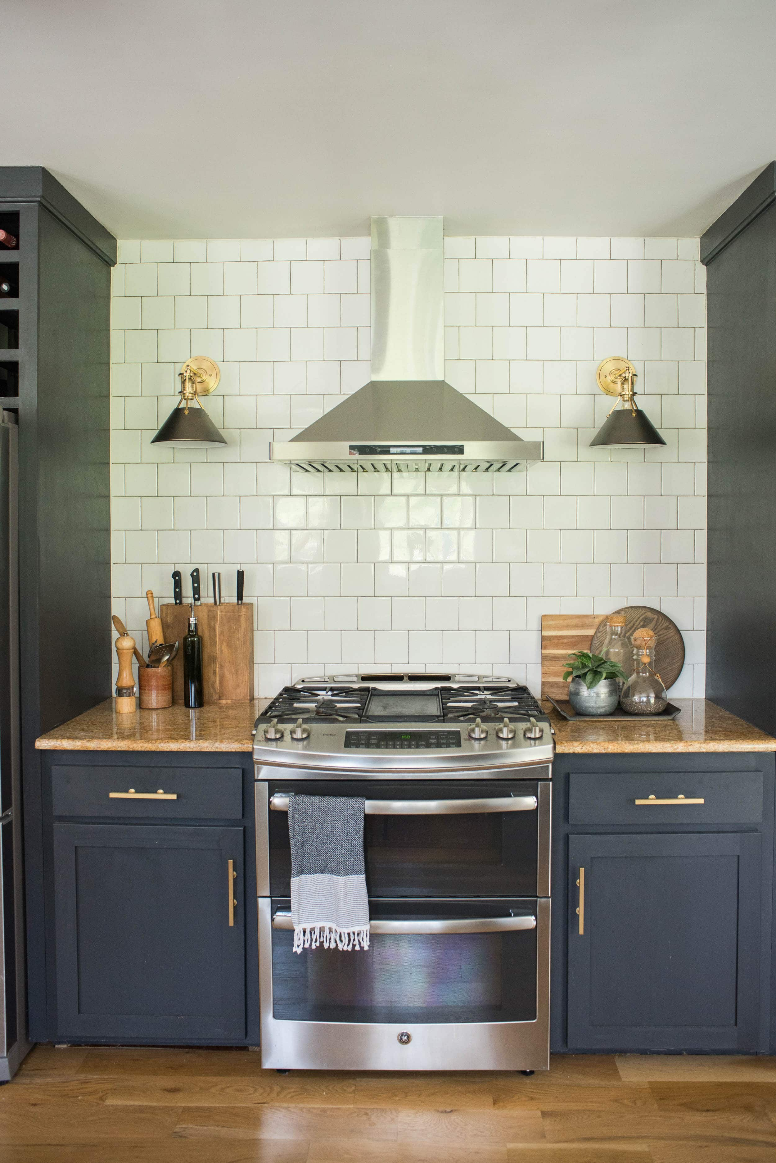 Kitchens sconces on each side of oven in kitchen