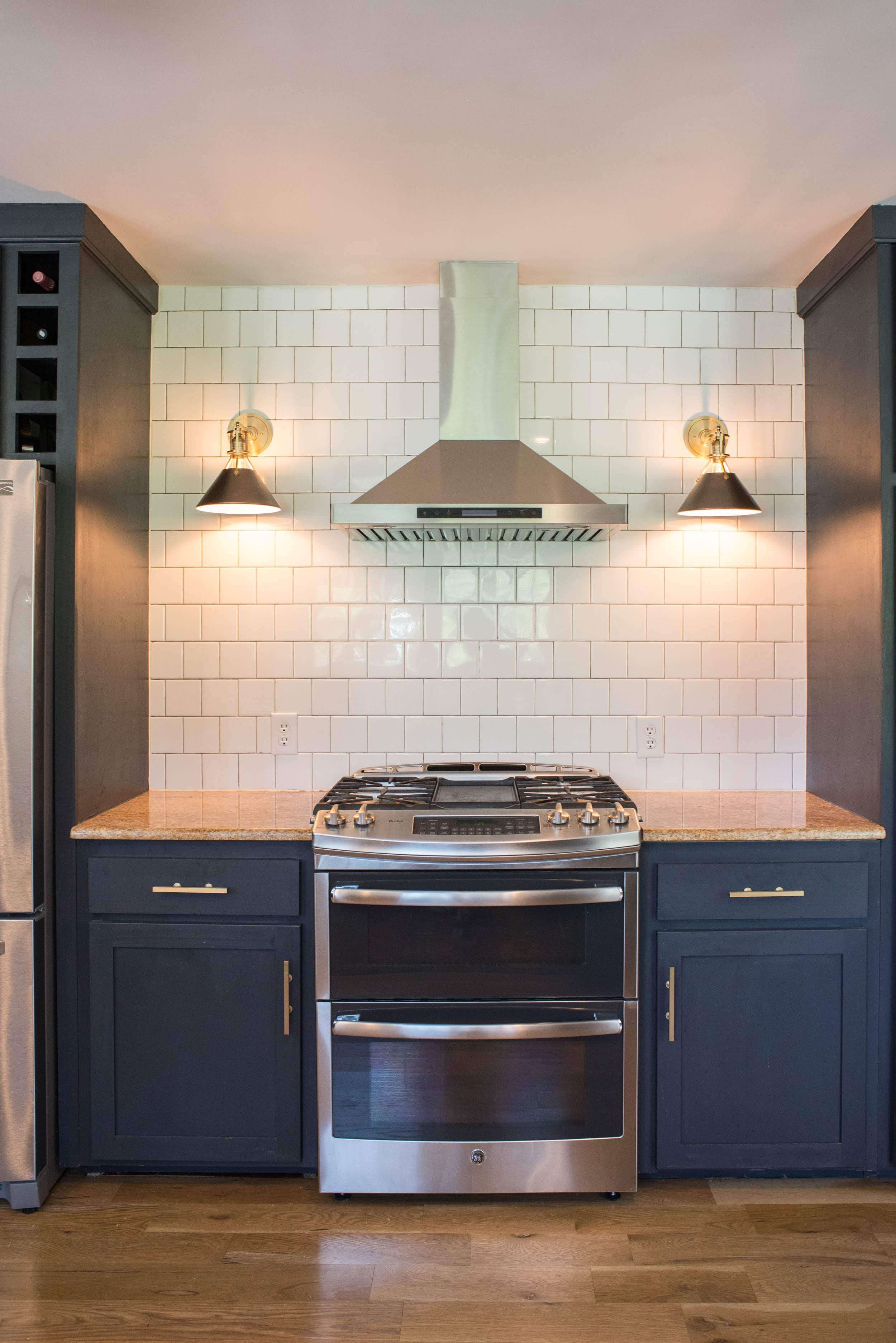 Kitchen with sconces flanking the oven