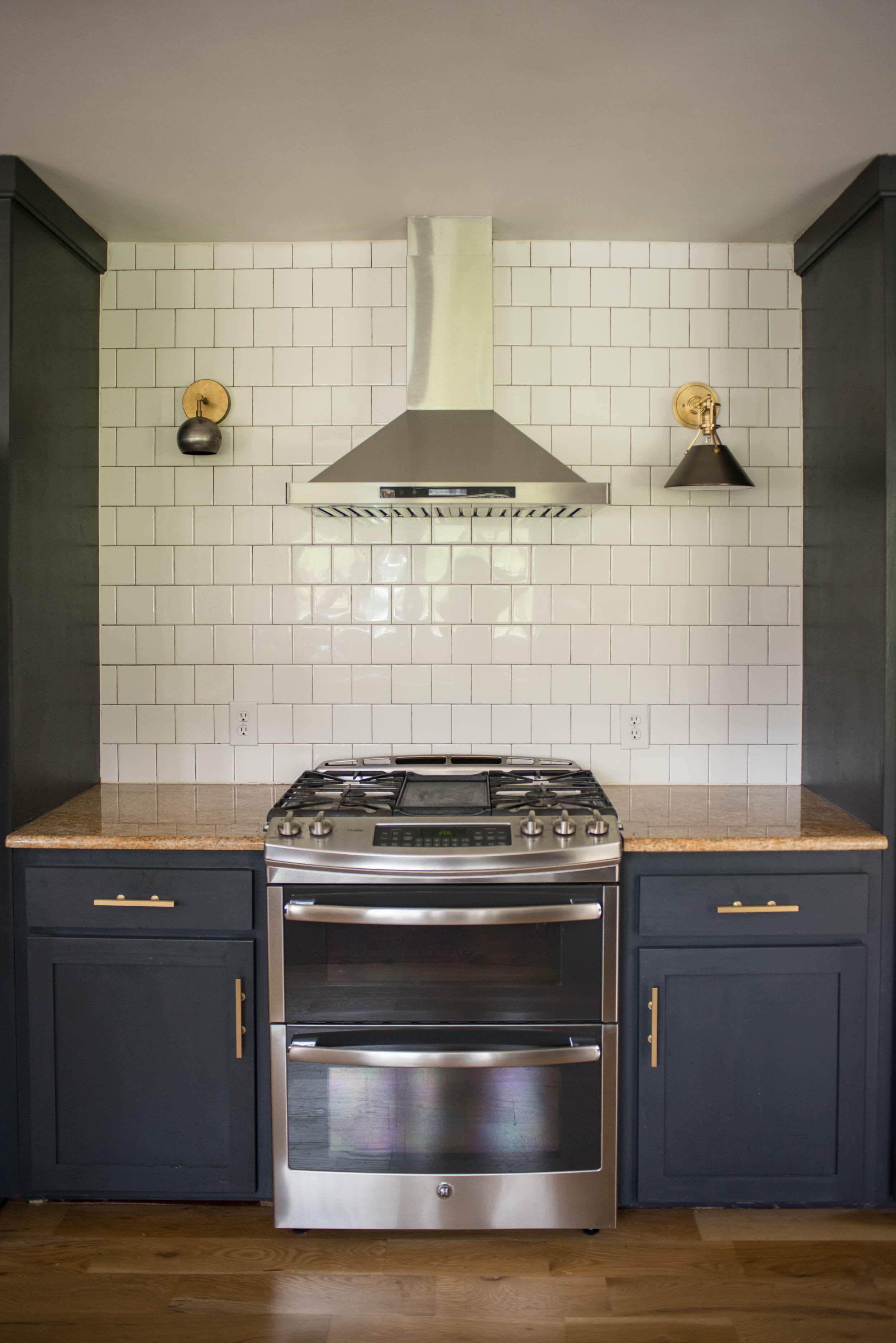 Different kitchen sconces showing scale on each side of oven.