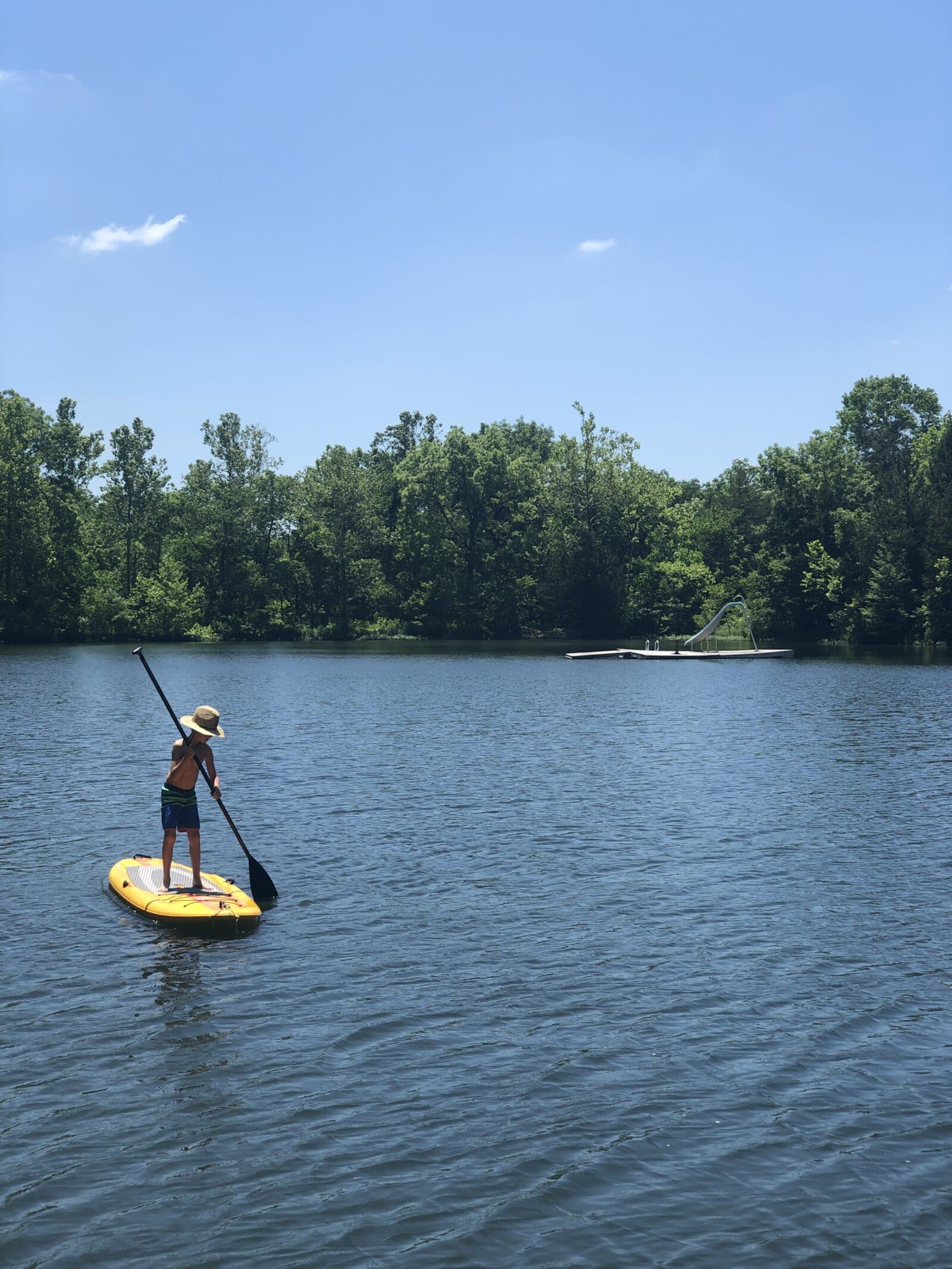 paddle board on lake with kid