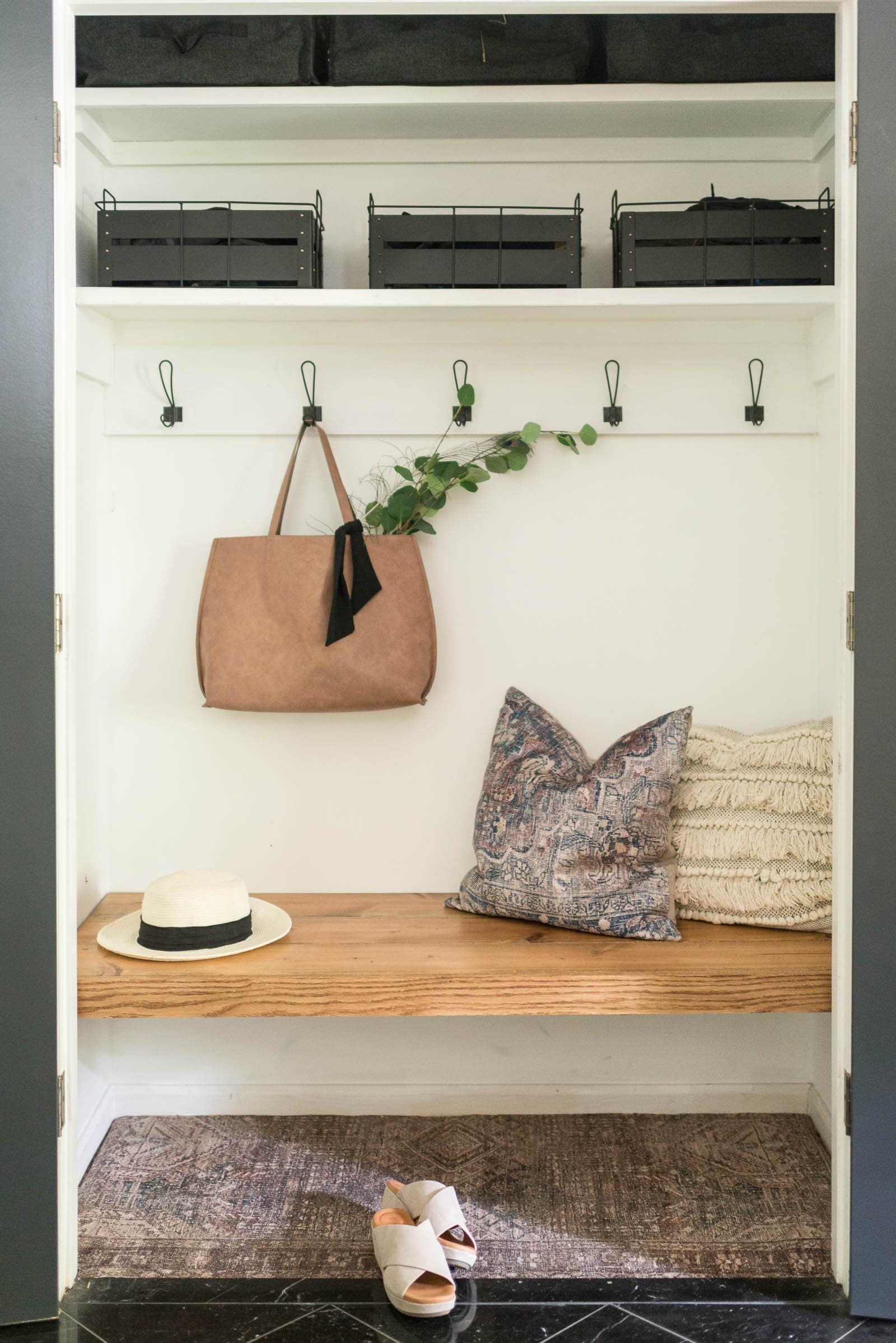 Entryway coat closet with DIY bench