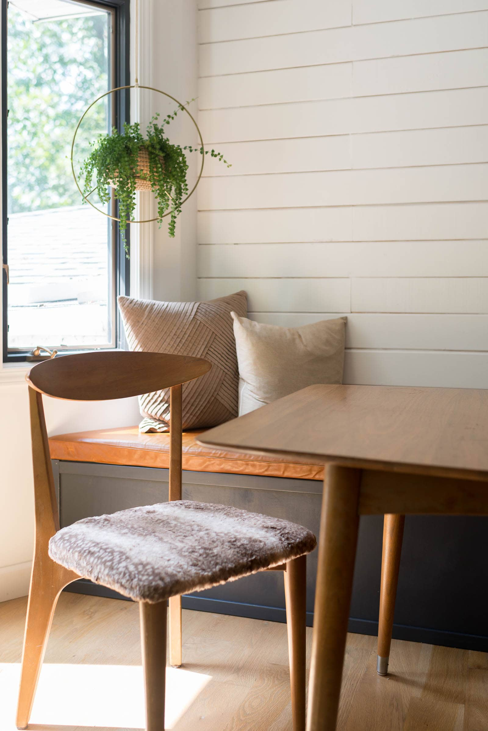 Midcentury chair by banquette in dining room