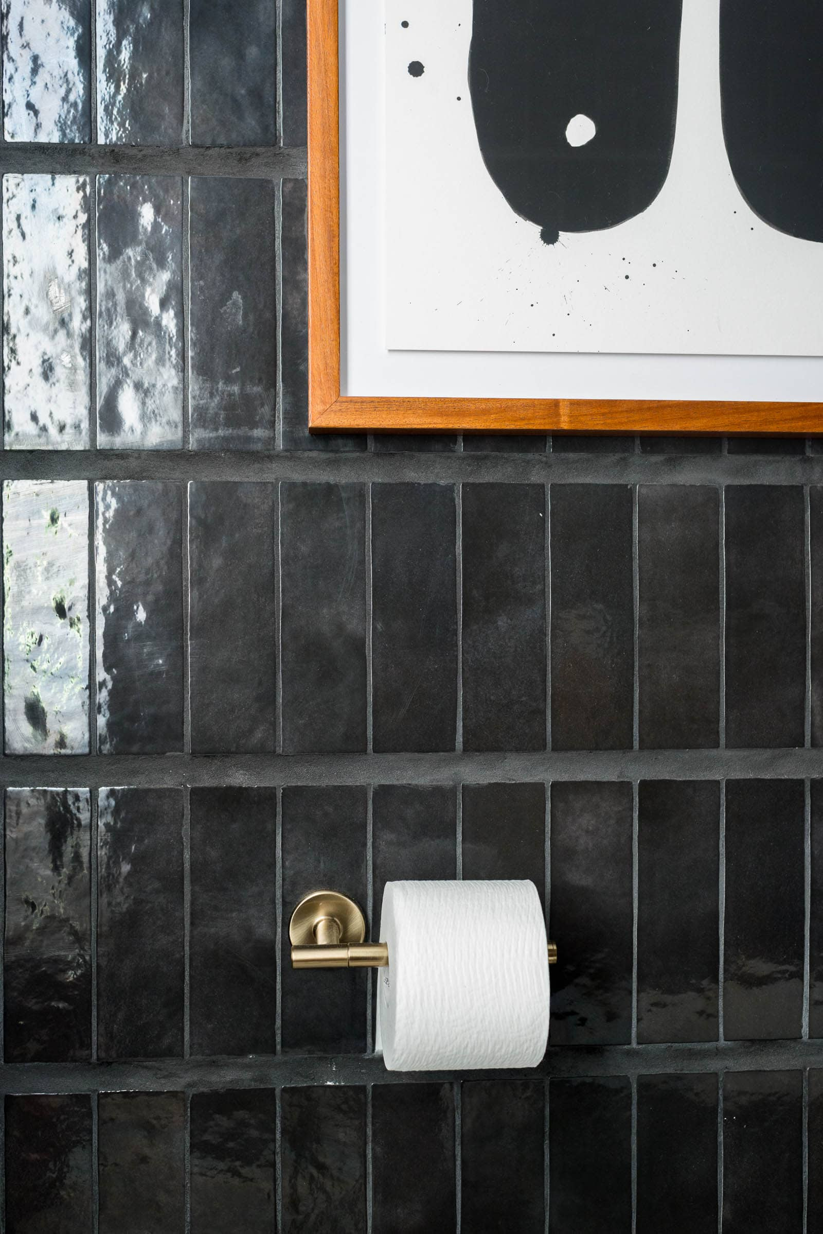Black wall tile in powder bathroom.